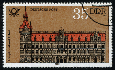 ddr: DDR - CIRCA 1982: A stamp printed in DDR shows Post office in Erfurt, circa 1982