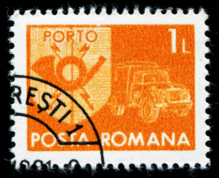 posthorn: ROMANIA - CIRCA 1974: A stamp printed in Romania shows a posthorn and mail van, circa 1974. Editorial