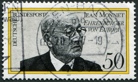 proponent: GERMANY- CIRCA 1977: stamp printed in Germany shows Jean Monnet, French proponent of unification of Europe, circa 1977.