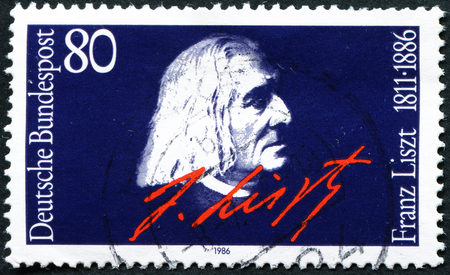 liszt: GERMANY - CIRCA 1986: A stamp printed in the Germany, dedicated to the 100th anniversary of his death Franz Liszt, portrait and signature, circa 1986