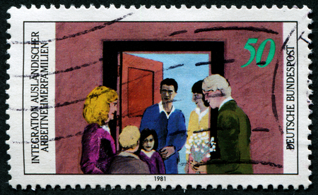 stempeln: GERMANY - CIRCA 1981: a stamp printed in the Germany shows people and inscription integration of foreign workers families, Germany, circa 1981