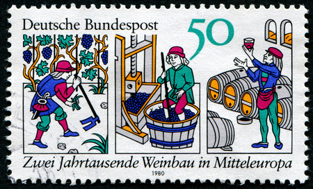 hoeing: GERMANY- CIRCA 1980: stamp printed by Germany, shows Hoeing, pressing grapes, win cellar, circa 1980. Editorial