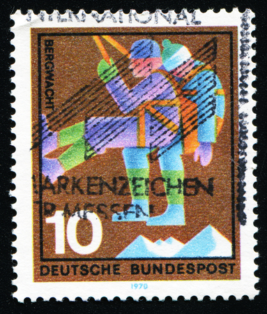 GERMANY - CIRCA 1970: A stamp printed in Germany from the Voluntary Relief Services issue shows Mountain Rescue, circa 1970. Editorial