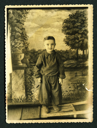 USSR - CIRCA 1951: Vintage photo shows studio portrait little boy, 1951