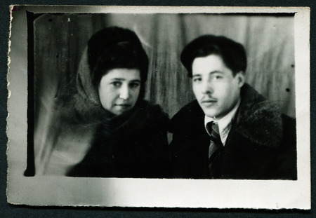 USSR - CIRCA 1950s: An antique photo shows portrait man and woman
