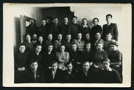 USSR - CIRCA 1954 : An antique photo shows group portrait of Soviet people, 1954