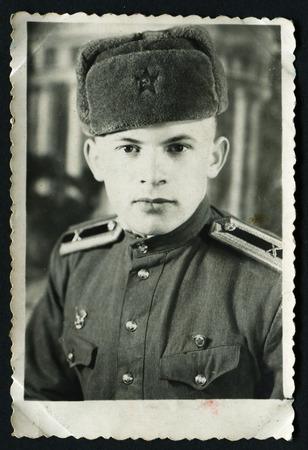 solders: USSR - CIRCA 1953: An antique photo shows solders portrait, 1953