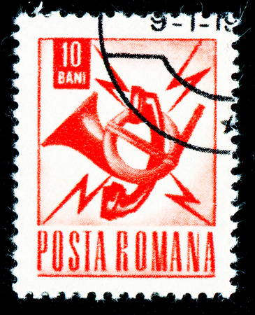 posthorn: ROMANIA - CIRCA 1967: A stamp printed in Romania shows posthorn and telephone emblem, circa 1967. Editorial