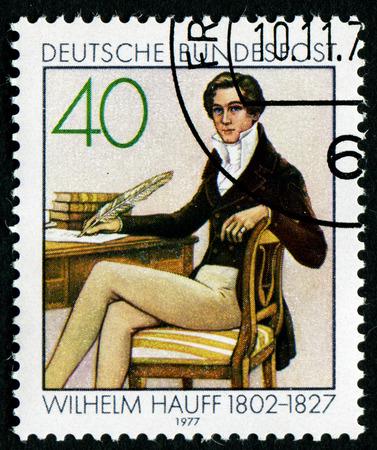 novelist: GERMANY - CIRCA 1977: A stamp printed in German Federal Republic shows Wilhelm Hauff - German poet and novelist, circa 1977 Editorial