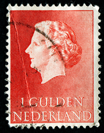 gulden: NETHERLANDS - CIRCA 1954: A stamp printed in the Netherlands shows image of Queen Juliana, series, circa 1954