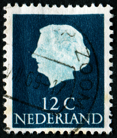 nederland: NETHERLANDS - CIRCA 1954: A stamp printed in the Netherlands shows image of Queen Juliana, series, circa 1954