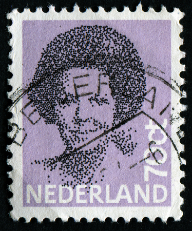 regnant: NETHERLANDS - CIRCA 1982: A stamp printed in Netherlands shows portrait of Queen Beatrix regnant of the Kingdom of the Netherlands, circa 1982 Editorial