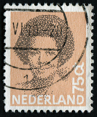 NETHERLANDS - CIRCA 1982: A stamp printed in the Netherlands shows image of Queen Beatrix, series, circa 1982 Editorial
