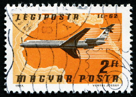 magyar posta: HUNGARY - CIRCA 1977 : A stamp printed in Hungary, shows Airlines and Maps with the inscription IL-62, from the series Airpost , circa 1977
