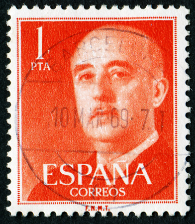 SPAIN - CIRCA 1955: Orange color postage stamp printed in Spain with portrait image General Francisco Franco.