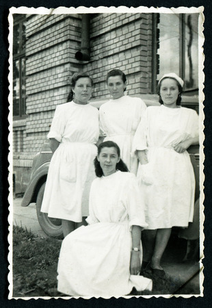 USSR - CIRCA 1950s: An antique photo shows four women in white coats, USSR, circa 1950s