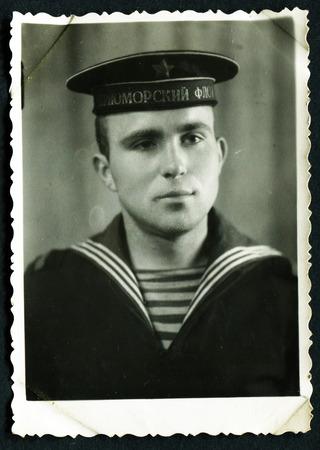 MURMANSK, USSR - CIRCA 1980: An antique photo shows portrait of a Baltic Navy submarine Midshipman in uniform.