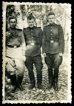 solders: USSR - CIRCA 1953: Three soldiers in the garden