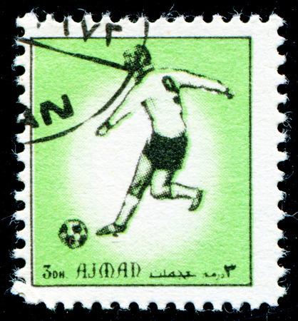 ajman: AJMAN - CIRCA 1972: A stamp printed in United Arab Emirates (UAE), shows football player, series, circa 1972 Editorial