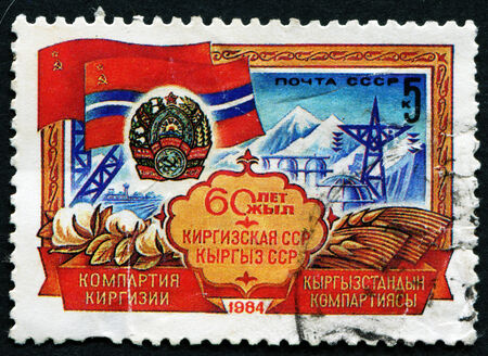 """USSR - CIRCA 1984: A stamp printed in the USSR, shows Arms and Flag of USSR republic with the inscription """"60 year Kirghiz SSR"""" , circa 1984"""