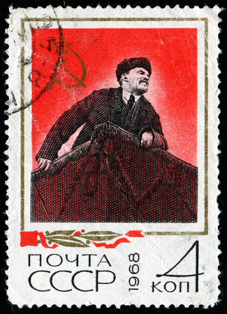 USSR - CIRCA 1968: A Stamp printed in USSR, shows Vladimir Ilyich Lenin in his hat with earflaps stands on podium, circa 1968