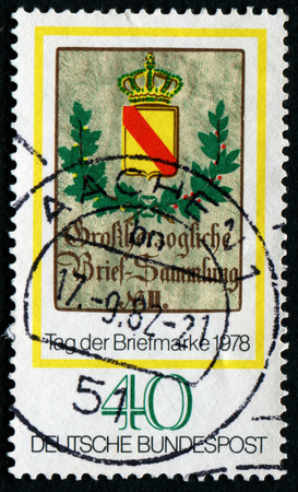 mailmen: GERMANY - CIRCA 1978: A stamp printed in the Germany, dedicated to the Stamp Day and German Philatelists Meeting, Frankfurt am Main, is shown Baden Posthouse Sign, circa 1978