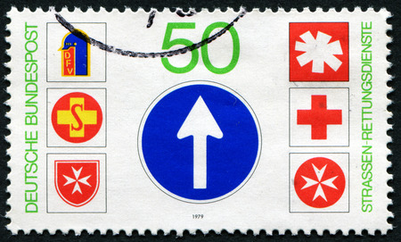 bundespost: GERMANY - CIRCA 1979: A stamp printed in Germany from the Rescue Services on the Road issue shows Rescue Services Emblems, circa 1979. Editorial