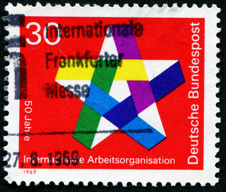 GERMANY - CIRCA 1969: a stamp printed in the Germany shows Five-pointed Star, 50th anniversary of the International Labor Organization, circa 1969