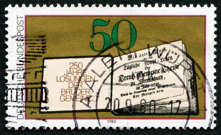 GERMANY - CIRCA 1980: A stamp printed in Germany issued for the 250th anniversary of Moravian Brethrens Book of Daily Bible Readings shows First Book of Daily Bible Readings, 1731, circa 1980.