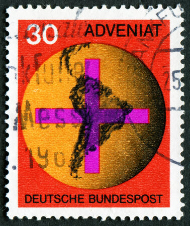 bundes: GERMANY - CIRCA 1967: A stamp printed in Federal Republic of Germany honoring Adveniat - Aid for Catholic Church in Latin America, shows Cross on South American Map, circa 1967