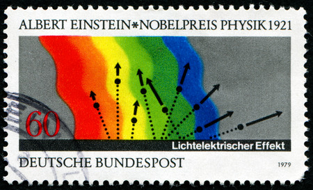 photoelectric: GERMANY-CIRCA 1979:A stamp printed in Germany shows image of In the photoelectric effect, Albert Einstein, circa 1979. Editorial