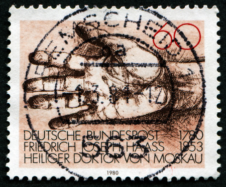 philanthropist: GERMANY - CIRCA 1980: a stamp printed in the Germany shows Helping Hand, Dr. Friedrich Joseph Haass, Physician and Philanthropist, circa 1980