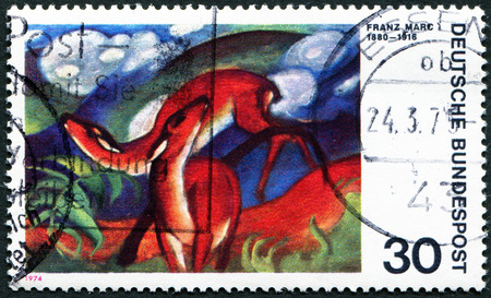 expressionist: GERMANY - CIRCA 1974: a stamp printed in the Germany shows Deer in Red, Painting by Franz Marc, German Expressionist Painter, circa 1974