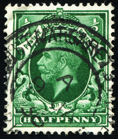 UNITED KINGDOM - CIRCA 1934: a Half Penny postage stamp printed in Great Britain (England) shows Portrait of King George V. Scott Catalog 210 A97 circa 1934 Editorial