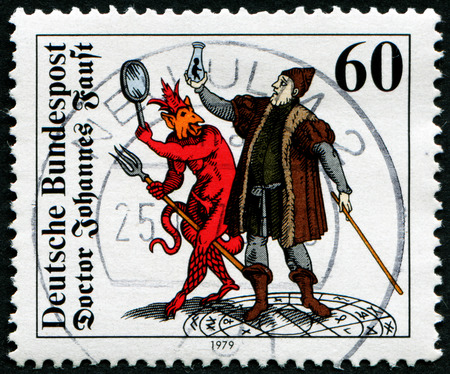 johannes: GERMANY - CIRCA 1979: A stamp printed in Germany, shows the Doctor Johannes Faust with Homunculus, Mephistopheles and Faust, Woodcut (1616), circa 1979