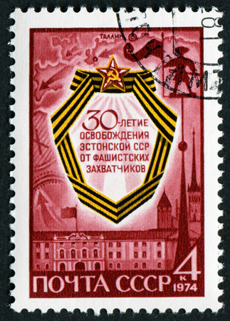 USSR - CIRCA 1974: A stamp printed in the USSR, shows memorial sign dedicated to the 30th anniversary of the liberation of Estonia from fascist invaders, circa 1974