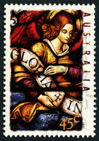 gloria: AUSTRALIA - CIRCA 1995: A stamp printed in Australia shows Angel with Gloria in excelsis Deo Banner, circa 1995 Editorial