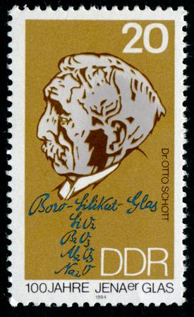 centenary: GDR - CIRCA 1990: a stamp printed in GDR shows Otto Schott, Chemist and Inventor of Borosilicate Glass, Jena Glass Centenary, circa 1990