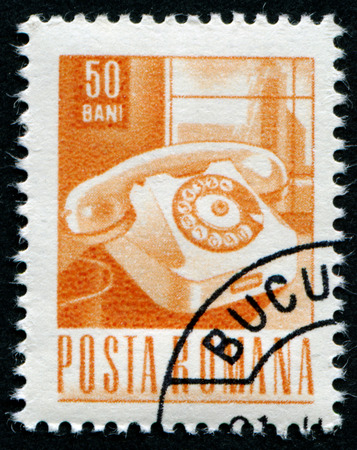 comprise: ROMANIA - CIRCA 1967: A stamp printed in Romania Shows Telephone, circa 1967 Editorial