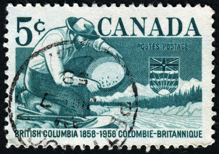 canada stamp: CANADA - CIRCA 1958: A stamp printed in Canada shows Miner Panning Gold, circa 1958 Editorial