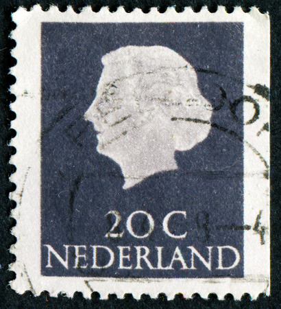 NETHERLANDS - CIRCA 1953: A stamp printed in the Netherlands shows Queen Juliana, circa 1953. Was Queen of Netherlands in the period September 4, 1948 to April 30, 1980.