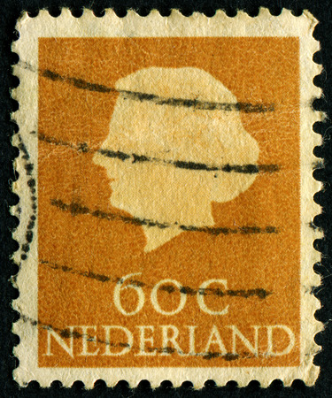 juliana: NETHERLANDS - CIRCA 1953: A stamp printed in the Netherlands shows Queen Juliana, circa 1953. Was Queen of Netherlands in the period September 4, 1948 to April 30, 1980.