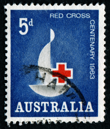 philatelic: AUSTRALIA - CIRCA 1963:A Cancelled postage stamp from Australia illustrating Centenary of Red Cross, issued in 1963.