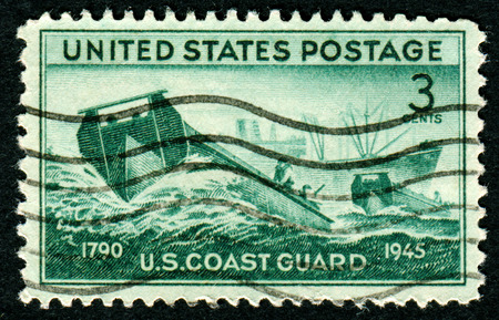 UNITED STATES - CIRCA 1945: A United States postage stamp celebrating the work of the US Coastguard, circa 1945. Editorial