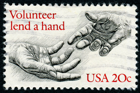 lend a hand: USA - CIRCA 1983: A stamp printed in USA shows the Human Hands, with the description Volunteer lend a hand, circa 1983