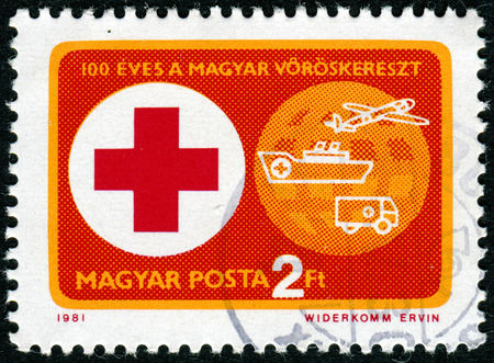 sello: HUNGARY - CIRCA 1981: A stamp printed in Hungary issued for the Centenary of Hungarian Red Cross shows Red Cross, Transport and Globe, circa 1981.