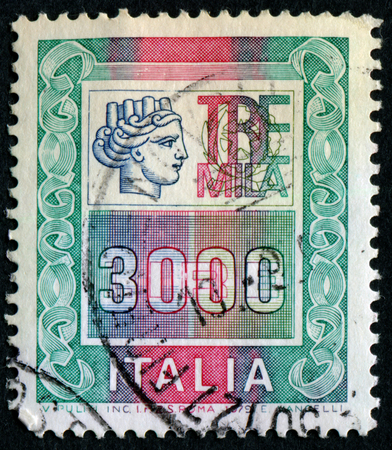 turreted: ITALY - CIRCA 1979: A stamp printed in Italy from the Italy turreted (Syracuse) issue showing the figure of an Ancient coin of Syracuse, circa 1979. Editorial