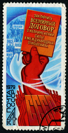 conclude: USSR - CIRCA 1979: A stamp printed in USSR, inscription to conclude a world treaty on the nonuse of force in international relations of the USSR, the hand raised up, circa 1979