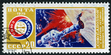 soyuz: USSR - CIRCA 1975: A stamp printed in USSR, shows docking of spacecraft Soyuz and Apollo, with inscriptions and name of series- Experimental flight of Soyuz and Apollo spaceship, circa 1975. Editorial