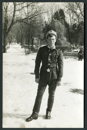 USSR - CIRCA 1970s: An antique photo show young soldier in winter park